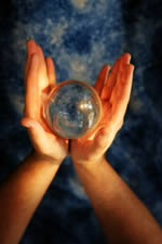 hands holding a crystal ball
